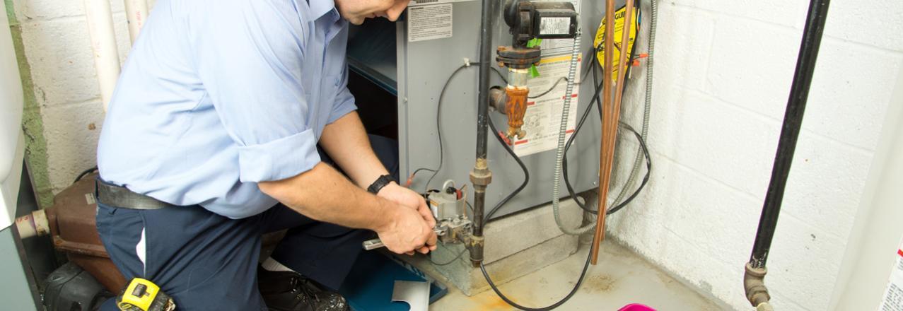 Green Collar, Technician repairing furnace, TX